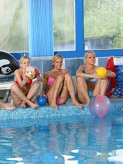 Watch three pierced lesbian teenies fucking poolside for you
