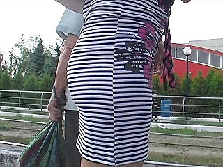 Pussy leaking up striped skirt