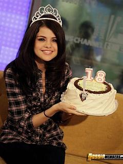 Teen superstar Selena Gomez blowing a birthday cake like a pro