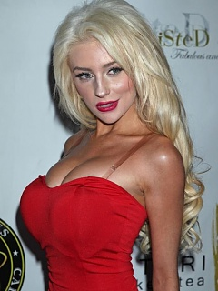 Courtney Stodden busty and slutty posing in a high-slit red dress
