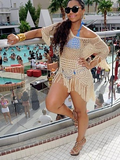 Picture compilation of curvy Ashanti wearing a blue bikini in Las Vegas