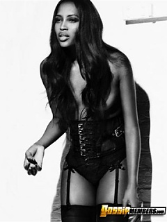 Naomi Campbell gets all-out skanky with her fine black titties exposed on the runway