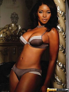 Tamala Jones shows of her chocolate boobies in too-small lingerie for a photoshoot