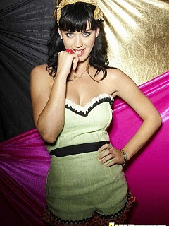 Katy Perry nonnude and showing cleavage in tight latex outfits while performing
