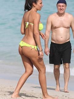 Hot paparazzi shots of Nicole Minetti in a sexy yellow thong bikini