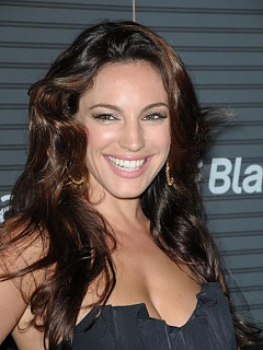 Gorgeous Kelly Brook posing for her fans in a stunning black short dress