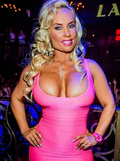Photos of hot sexy voluptuous Coco busting out of her pink dress