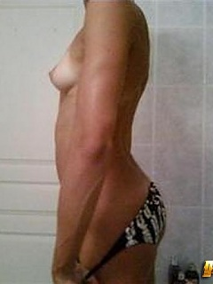 Laure Manaudou flashes her perky tits in a selfshooting session inside the bathroom